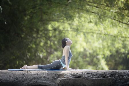Woman practice yoga with nature background Stockfoto