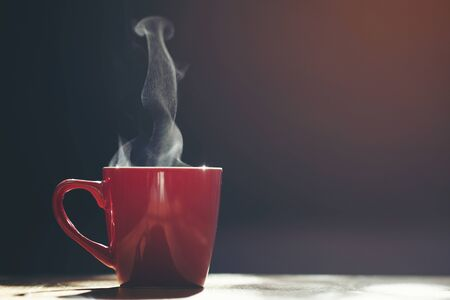 Red cup of coffee  on black background