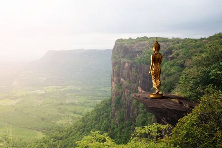 Buddha statue on mountain with nature background