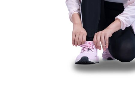 Woman tying laces isolated on white background