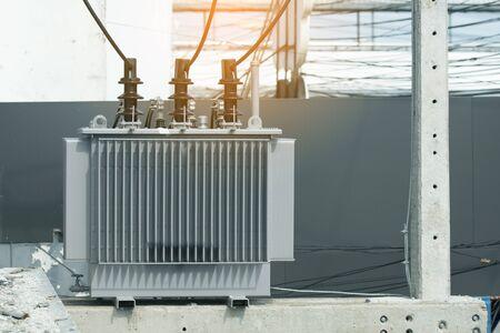 high-voltage power transformer on concrete pole