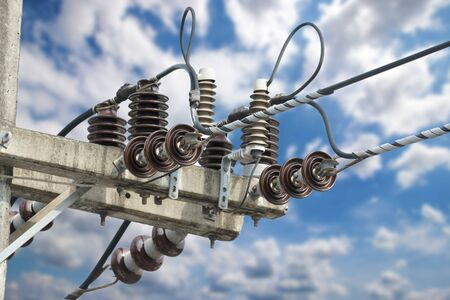 Electrical wire suspension insulators on the electrical post with cloud and blue sky background Stockfoto - 129176105