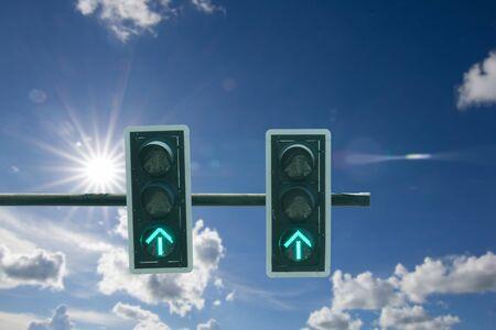 Traffic light against blue sky background