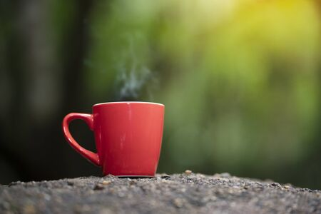 Red cup of coffee with natore background Stockfoto