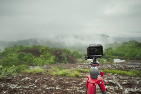 Action camera on tripod take photo with nature background Stockfoto