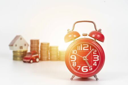 Clock,coins ,home and car finance and business concept. Stockfoto - 129429784