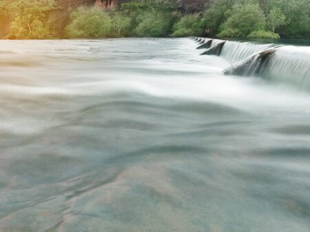 Water flow pass the weir Stockfoto - 129429969