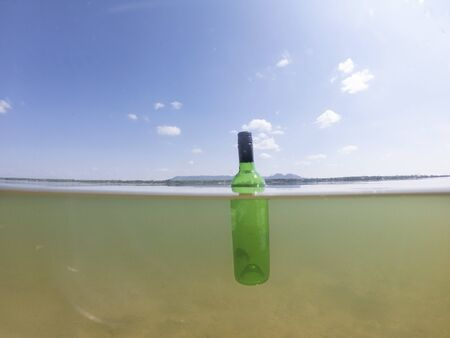 bottle floating in sea make environment pollution
