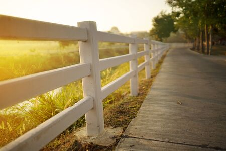 White concrete fence with path way