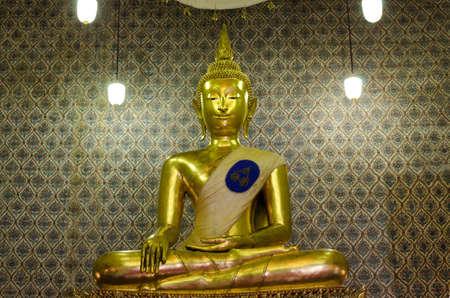 praye: golden buddha statue image in temple Thailand