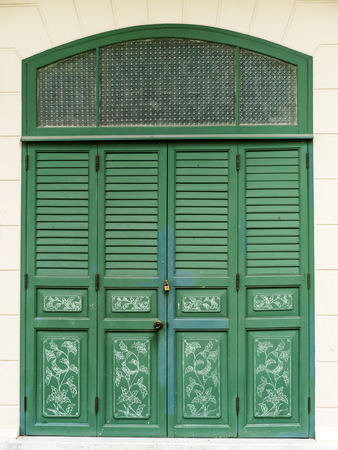 green door: Green door traditional style of Thai temple