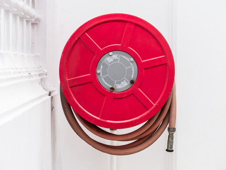 fire hoses: Fire hoses packed on the wall Stock Photo