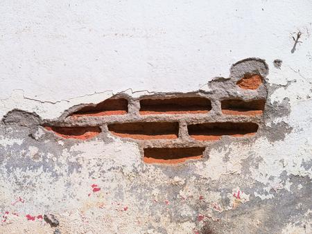 damaged: White brick wall damaged Stock Photo