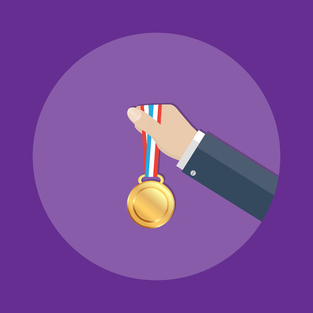 triumphant: Gold medal in Business hand.Business success,business concept ,