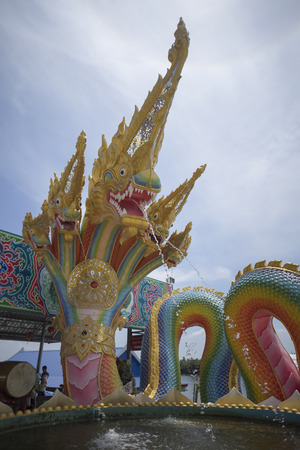 serpents: Serpents are spraying water, King of Nagas , serpent in Thailand and blue sky corona background
