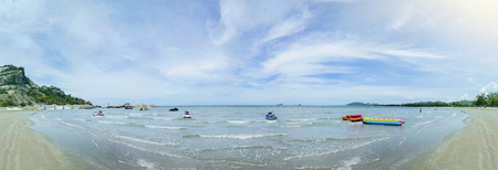 lebanon beach: panorama view of the blue sea and clean beach with beautiful blue sky and cloud, jetski ,banana boat on a surface of sea, filtered image Stock Photo