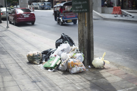 BANGKOK THAILAND-july 18,2016 : Garbage bags on the footpath in Bangkok province,thailand ,selective focus.