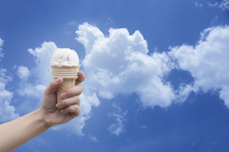 gelati: a woman hand holding Ice cream cone with summer blue sky and clouds in background,colorful picture style