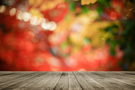 colorful light display: Wooden board empty table in front of colorful blurred background. Perspective brown wood over bokeh light, can be used for display or present your products.Mock up your products