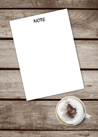 barnwood: note paper put on a old grunge wooden texture table with a cup hot coffee,top view, space for add your text or graphic editor