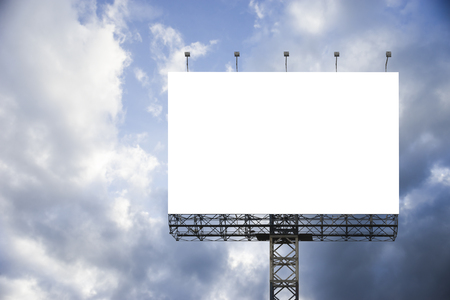 display advertising: Blank big billboard against blue sky background,for your advertising,put your own text here,isolate white on board