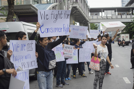 deception: Bangkok, Thailand : september 26, 2016 - fords car user get a flash mob at Ford Motor Company, Thailand at Sathorn Square office tower to call for justice about gear problem in ford fiesta car,Deception customer of by ford thailand conpany