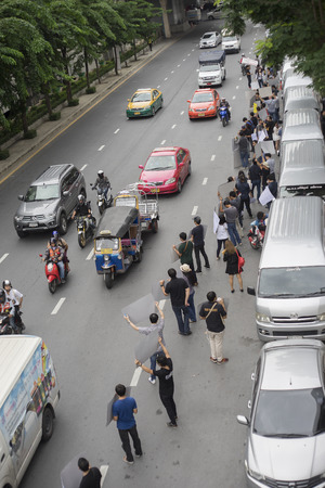mob: Bangkok, Thailand : september 26, 2016 - fords car user get a flash mob at Ford Motor Company, Thailand at Sathorn Square office tower to call for justice about gear problem in ford fiesta car,Deception customer of by ford thailand conpany