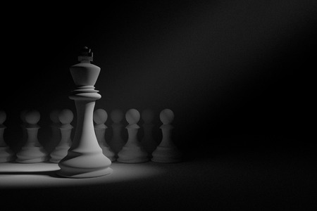 outwit: 3D Rendering : illustration of chess pieces.the king chess at the center with wooden pawn chess in the back.light drop at the king.leader concept.success concept,business leader concept