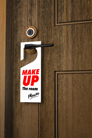 doorknob: 3D : Illustration of white Paper signboard with make up the room please hanging on a handle of wooden door resort or hotel Stock Photo