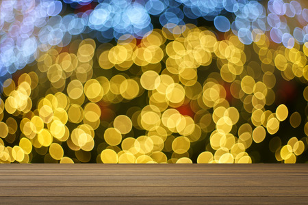 Empty wood table and blurred bokeh out of focus in christmas night light background. product display template. Business presentation