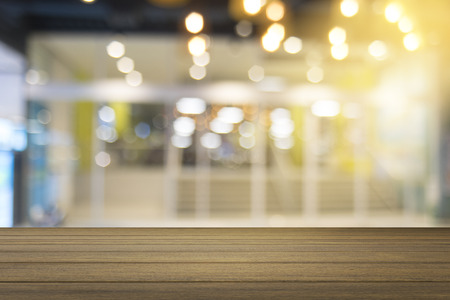 Empty wood table and blurred shopping mall in background. product display template. Business presentation Stock Photo