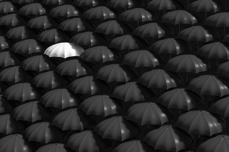 mainstream: 3D Rendering : illustartion of white umbrella stand out from the crowd of many black and white umbrellas. Business, leader concept, being different concepts Stock Photo