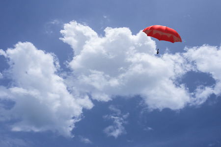 3D Rendering : illustartion of Red umbrella floating above against blue sky and clouds. Business, leader concept, being different concepts;1st position