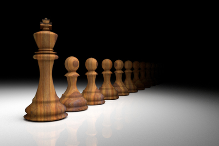 3D Rendering : illustration of chess pieces.the wooden king chess at the center with pawn chess in the back.light drop to the chess.leader success concept.business leader concept.winner Stock Photo