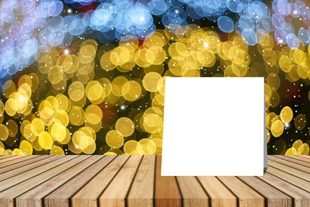white card put on table and blurred bokeh out of focus in christmas night light background. product display template. Business presentation.clipping path include Stock Photo