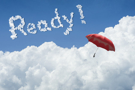 red umbrella floating above against Blue sky and cloud.Sunny day.Cloudscape.close up the cloud.text ready.get ready concept.get ready to better life in new year 2017 concept.ready for fight everything