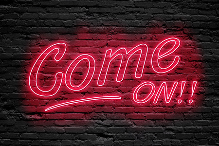 banner ads: COME ON. fluorescent Neon tube Sign on dark brick wall. Front view. Can be used for online banner ads or background. night moment.
