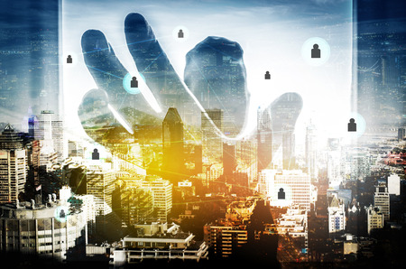 Double exposure photo a business man catching network sign or grab a future success in new technology concept and view of the city. social network business. fight for big success. abstract background