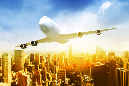 Commercial airplane flying above blue sky and clouds over city view. close up airplane flying or taking off. traveling tour with airline concept. commercial plane or logistic concept. filtered image