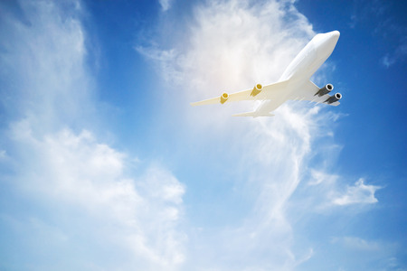 Commercial airplane flying above blue sky  and clouds. close up airplane flying or taking off. traveling tour with airline concept. commercial plane or logistic concept. filtered image