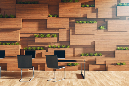 3D rendering : illustration of new modern style conference room interior design with pc laptop on the desk in a room with wooden blocks wall and wooden tile floor. meeting room.
