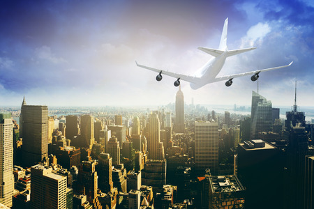 Commercial airplane flying above blue sky and clouds over city view. close up airplane flying or landing. travel tour with airline concept. commercial plane or logistic concept. filtered image