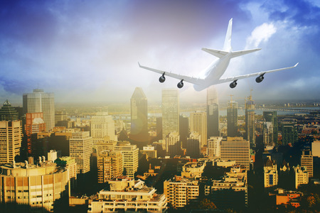 Commercial airplane flying above blue sky and clouds over city view. close up airplane flying or landing. traveling tour with airline concept. commercial plane or logistic concept. filtered image