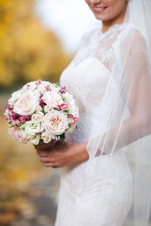 arm bouquet: the bride holding a wedding bouquet close up