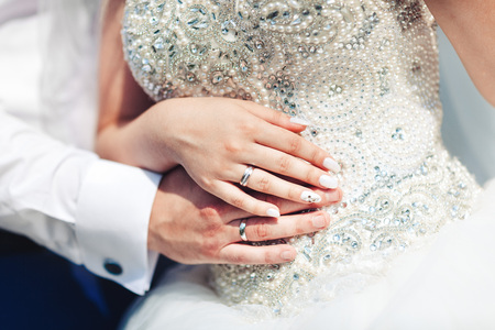 hand with wedding rings together