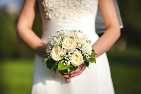 arm bouquet: wedding bouquet in hands of the bride Stock Photo