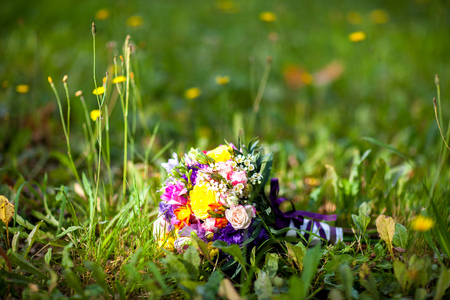 field maple: Wedding bright bouquet of flowers on the grass Stock Photo