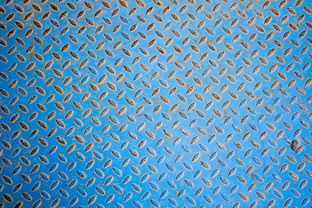 bumpy: Background of a blue industrial metallic floor with a bumpy pattern