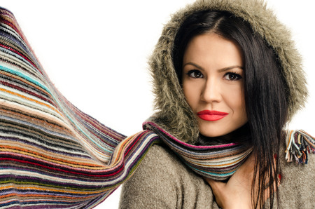 faux: Sexy young brunette girl with red lips in autumn. Portrait of a young attractive woman wearing a sweater with faux fur hood Stock Photo