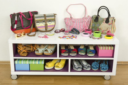 box design: Lots of colorful summer accessories on a shelf. Bags, jewelry, shoes and sandals nicely arranged on a shelf